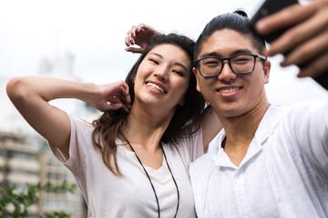 Portrait of Asian Couple Smiling