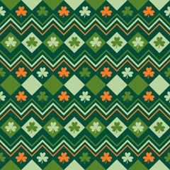 Irish green and orange seamless pattern with shamrock leaves