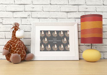 White Photo Frame with Toy and Table Lamp Mockup 1