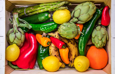 Wooden box with vegetables and fruits healthy and real food