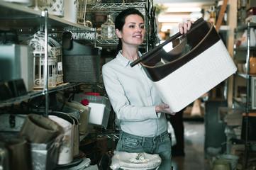 Glad woman  choosing purpose basket