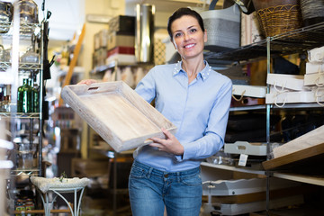 purchaser holding a wooden boxes