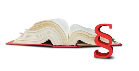 aufgeschlagenes Gesetzbuch und Paragraph symbol