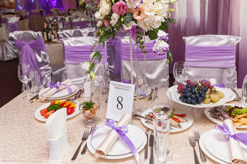 A decorated wedding table with room number eight. Served wedding table.