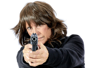 Mature Woman pointing a Gun