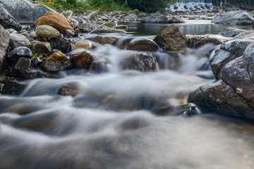 beautiful scenic mountain lanscape river waterfall shot with a ND filter and slow shutter technique
