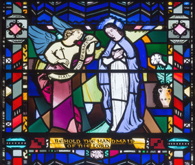 LONDON, GREAT BRITAIN - SEPTEMBER 16, 2017: The Annunciation on the stained glass in church St Etheldreda by Charles Blakeman (1953 - 1953).
