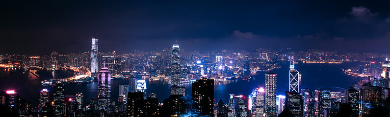 Wall Mural - May 20, 2017. Hong Kong. Amazing panoramic night aerial view of the Hong Kong city. City panorama with lights.