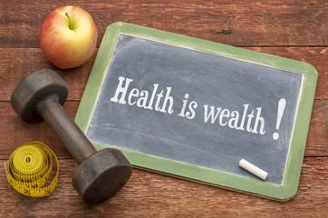health is wealth text on blackboard