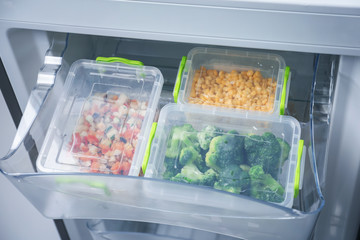 Frozen vegetables in refrigerator icebox
