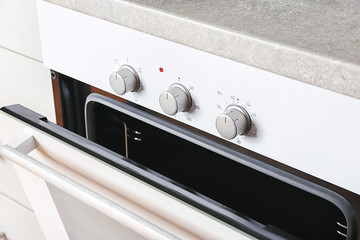 Modern electrical white oven in kitchen