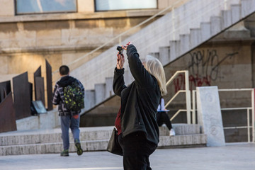 Tourist woman photographing the streets of europe