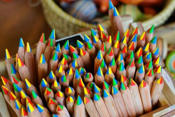 Bunch of wooden color pencils with a multicolor tip