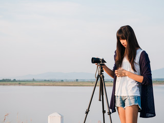 young asian woman photography with tripod