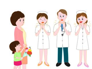 小児科を退院する子供を見送る医者と看護師