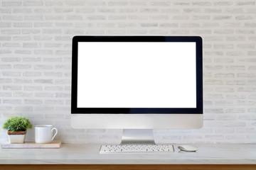 Mockup desktop blank screen computer and coffee mug on table.