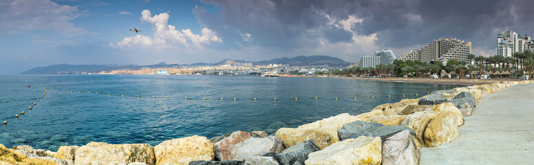 Panoramic view on central public beach of Eilat - the southernmost port and famous resort and recreational city in Israel