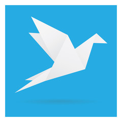 white bird paper craft flying in frame art isolated on blue background