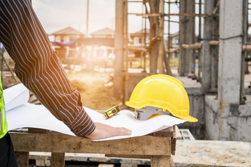 professional engineer worker at the house building construction site