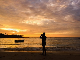 The guy photographing the sunset on the sea