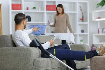 injured boyfriend and girlfriend working at home