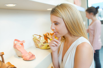 Young woman in a shoe store
