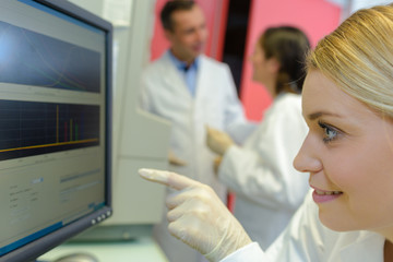 medical scientists using digital machinery at laboratory
