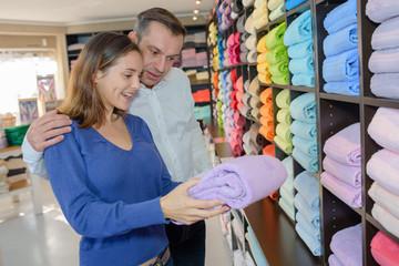 Couple in store choosing towels