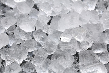 crushed ice cube texture on black background