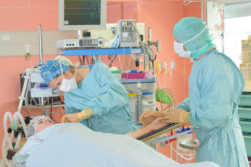 surgeons are operating in a hospital