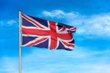 British union jack flag waggling in the wind with sky