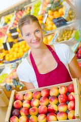 girl holding basketful of apples