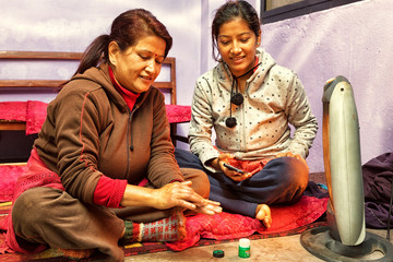 Mother and Daughter in front of Heater, Nepal