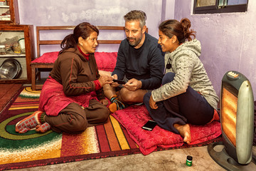 Looking at Pictures on the Smartphone, Home Stay, Nepal