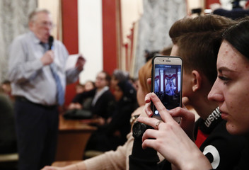 A student uses her mobile phone to shoot a video of leader of the Liberal Democratic Party of Russia and presidential candidate Zhirinovsky during a meeting with youth at the Tula State University in Tula