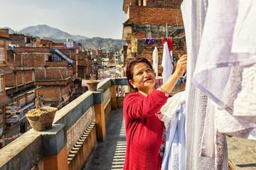 Taking off the Laundry, Panauti, Nepal