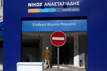 A man walks in the head office of Presidential candidate Nicos Anastasiades of the right wing Democratic Rally party in Nicosia