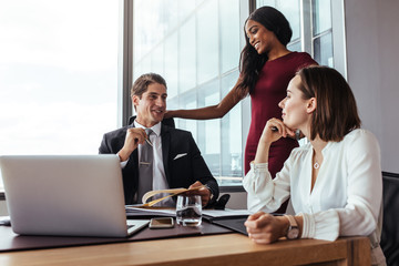 Businessman working with female colleagues in office