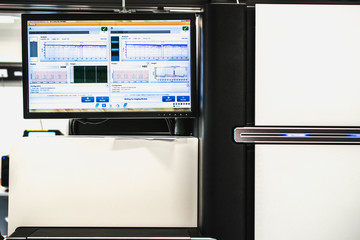 Computer and Genome DNA Sequencer. Technology or laboratory abstract background for Next Generation Sequencing.
