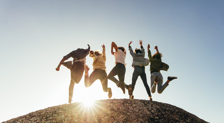 Group of happy friends having fun on mountain top