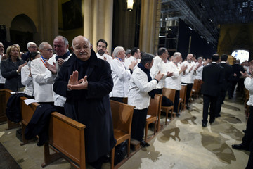 French chef Pierre Troisgros applauds as the coffin of French chef Paul Bocuse leaves the Saint-Jean Cathedral after a funeral service in Lyon