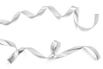 Silver ribbon bow in bright silver white grey color isolated on white background with clipping path for holiday and party greeting card design decoration element