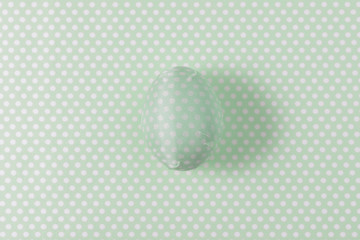 Easter egg decorated with green paper napkin. Minimal concept.