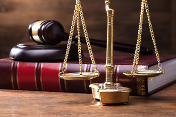 Judge Golden Scale In Front Of Gavel And Law Book