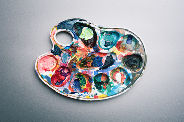 Palette of paints on a gray background
