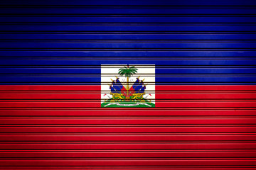 Haiti caribbean Flag sign in iron garage door texture, flag background