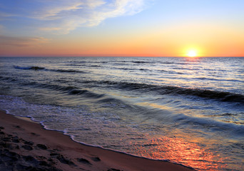 Colorful sunset over the Baltic Sea shore and beach in Rowy, Poland