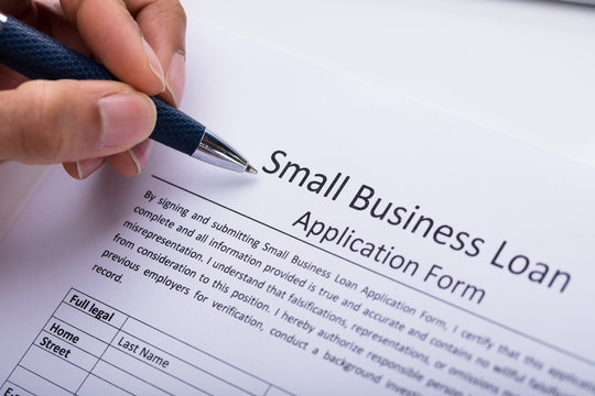 Businessperson Filling Small Business Loan Application Form