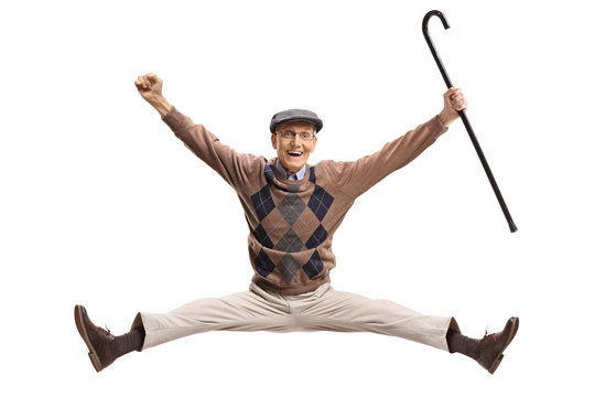 Overjoyed senior with a cane jumping