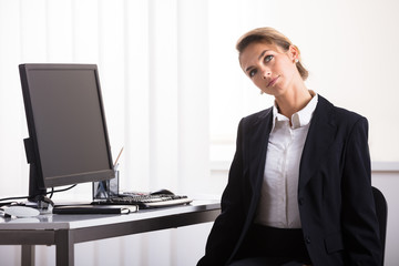 Businesswoman Doing Neck Exercise